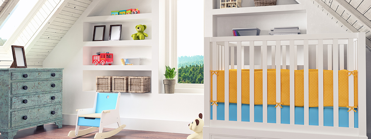 Baby nursery room with crib, rocking chair and toys
