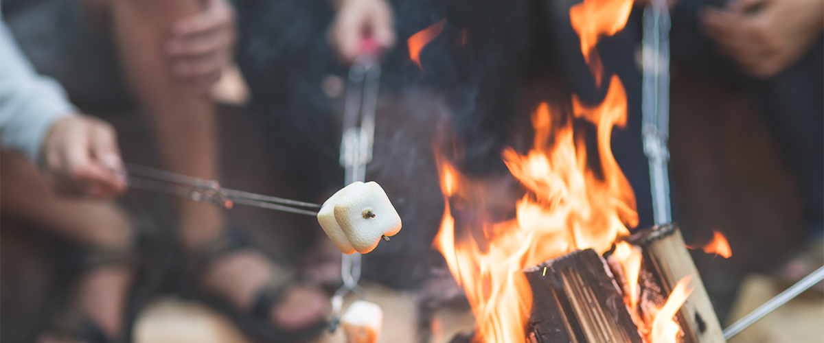Roasting marshmellows on campfire