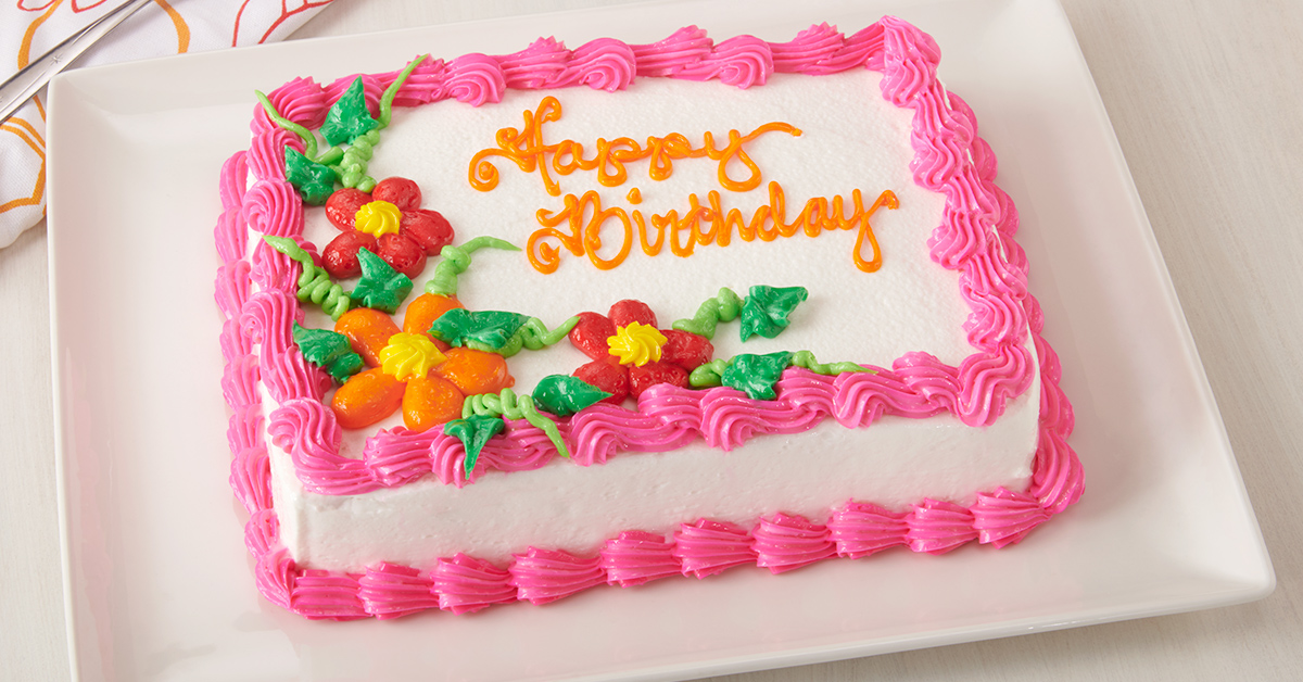 Happy birthday cake decorated with frosting in floral pattern