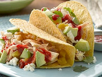 corn shell tacos filled with rotisserie chicken and avocado