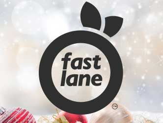 fast lane logo and Christmas ornaments in front of falling snow